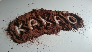 "Word ""kakao"" traced in cocoa powder"